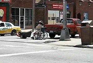 lawn mower drawn wheelchair